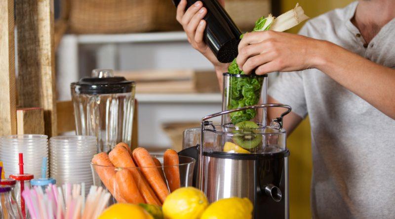 Male staff preparing a juice