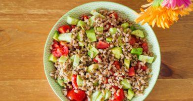 Fresh farro spelt salad with tomatoes, avocado
