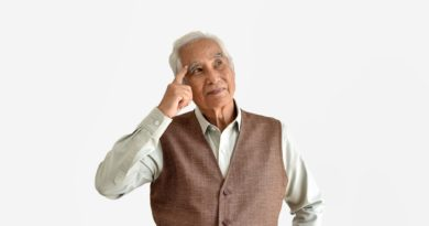 Confusing and forgetful elderly asian man with thinking gesture