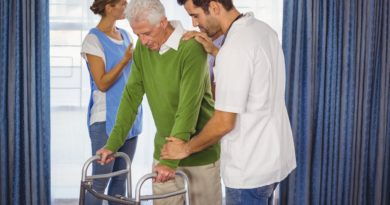 Nurse helping seniors walking with a walker