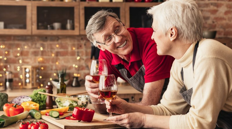 Romantic senior couple preparing healthy meal together